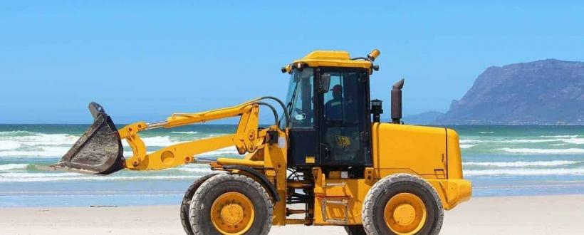 An excavator on a beach